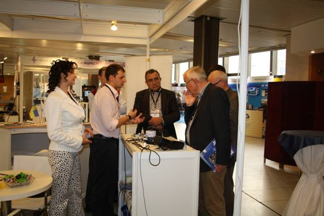 Demonstration of a brand-new portable equipment made by OKOndt GROUP to the  ECNDT-2014 attendees