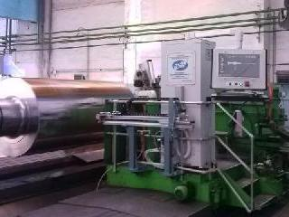 Automated ultrasonic and eddy-current system for mill…